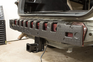 Foam cushion over the bumper beam, and hitch installed.