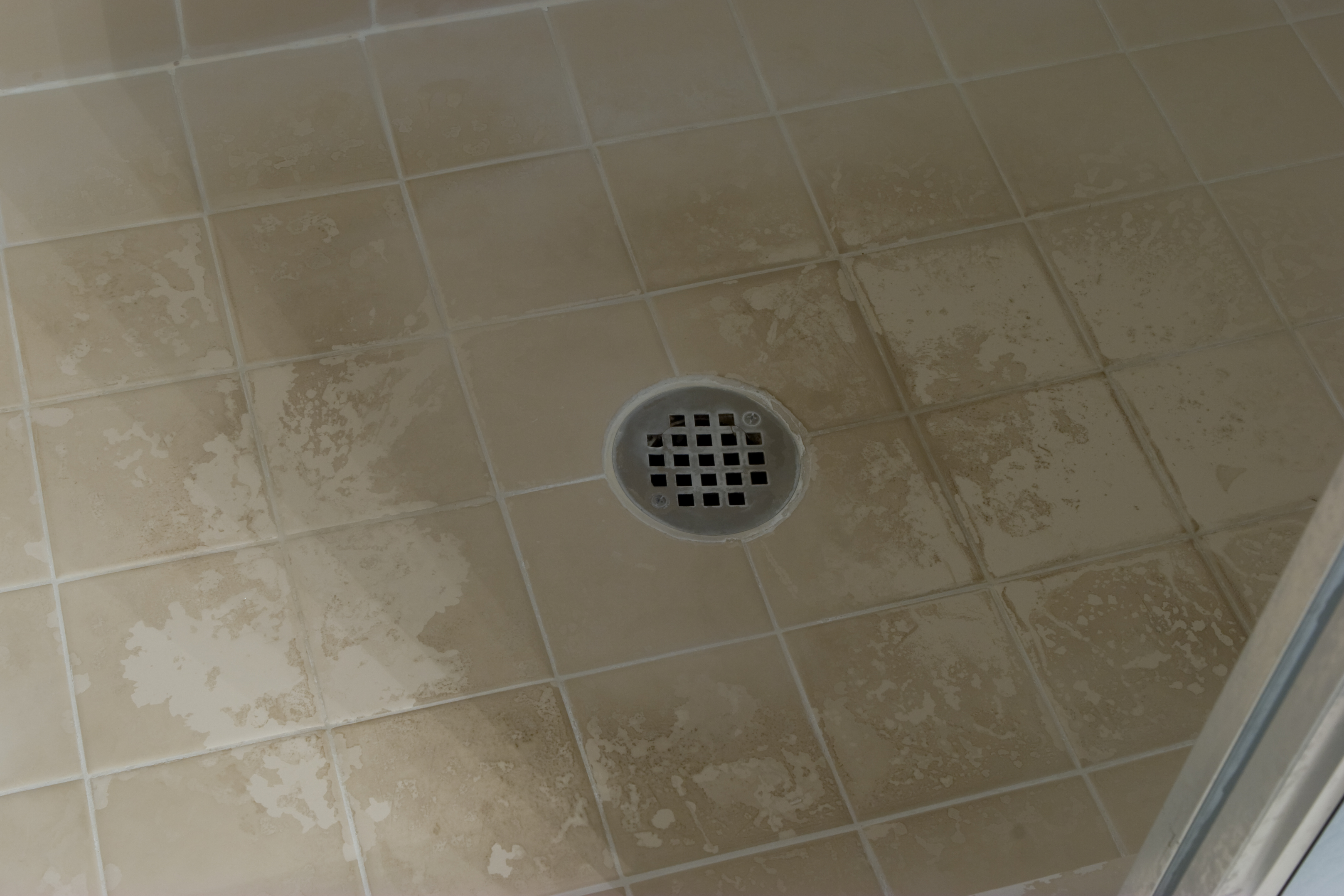 Soap scum on the floor of my shower after many months of for Soap scum on shower floor